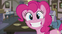 Pinkie grinning wide at the Apples S5E20