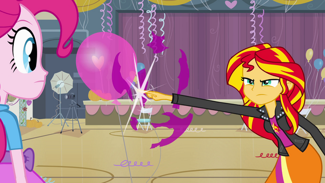 File:Sunset pops balloon with her finger EG.png