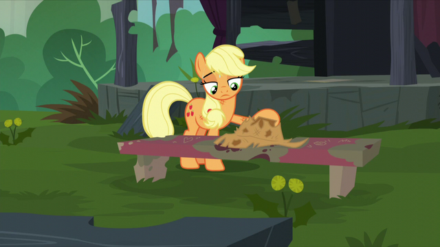 File:Applejack puts her hat on a bench S5E16.png