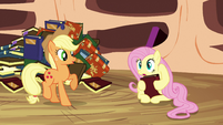 Fluttershy holds a book with her hooves S3E05