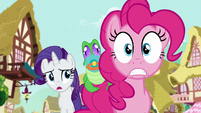 Pinkie with a nervous expression as Rarity asks her what she's talking about S5E19