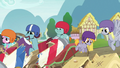 Derby racers in a pile of wrecked carts S6E14.png