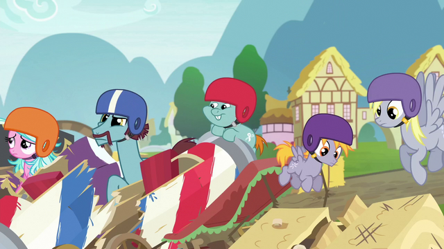 File:Derby racers in a pile of wrecked carts S6E14.png