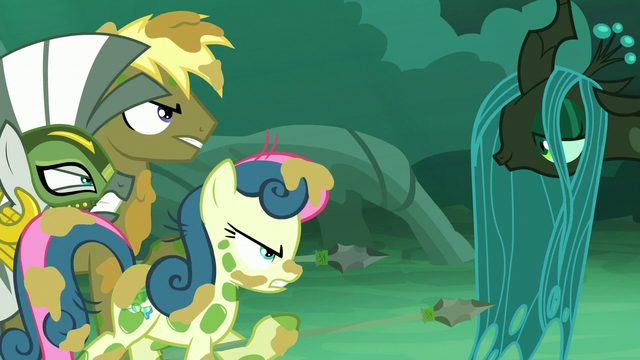 File:Coco Crusoe and Sweetie Drops pointing their spears to Chrysalis S5E26.png