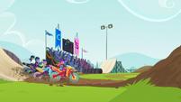 Motocross racers land on the dirt path EG3