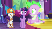 Rarity smiles nervously at Spike S6E5