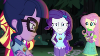 Rarity grinning nervously at Twilight EG4