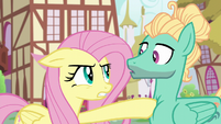 Fluttershy poking Zephyr with her hoof S6E11
