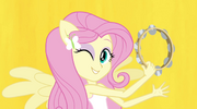 Fluttershy on yellow Better Than Ever backdrop EG2.png