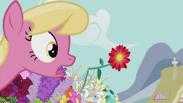 File:Lily looking at a zinnia with a broken stem S5E9.png