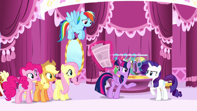 File:Twilight levitates the newspaper away from Rarity S6E9.png