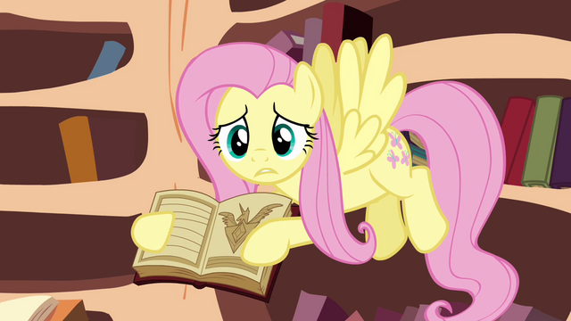 File:Fluttershy trying to get her friends to see the book S3E05.png