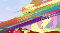 Rainbow flying past Fluttershy and Applejack S3E7