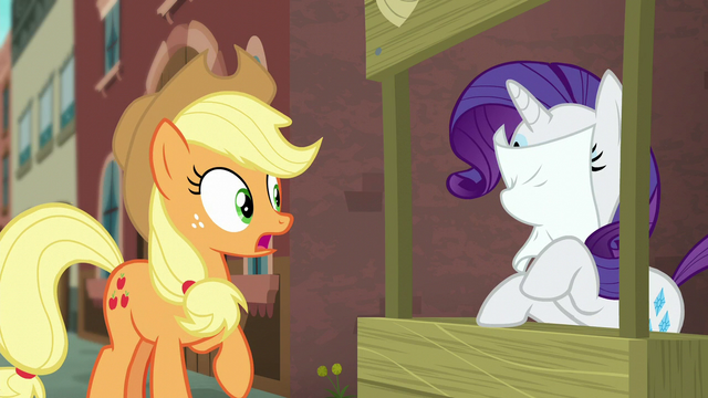 File:Coco's flyer flies into Rarity's face S5E16.png
