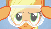 Applejack putting on safety goggles S6E10