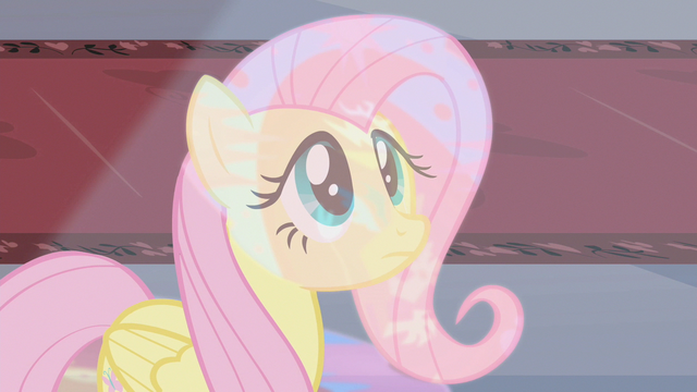 File:Fluttershy looking up at stained glass S2E01.png