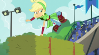 Applejack deftly leaps over a hay bale EG3