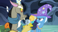 Discord takes a microphone out of Trixie's bag S6E25