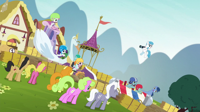 File:Spectators cheer for passing racers S6E14.png