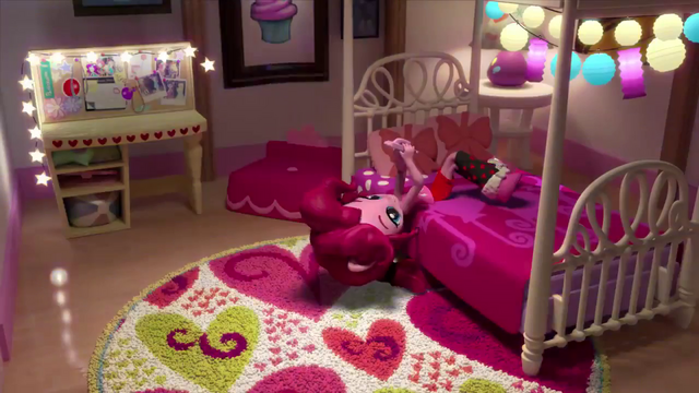 File:Pinkie Pie texting on her bed (version 2) EGM1.png
