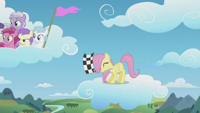 File:Filly Fluttershy waves the checkered flag S5E25.png