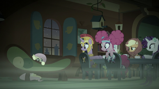File:Main five see Fluttershy hiding behind a couch S5E21.png