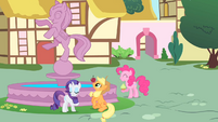 Rarity, Applejack, and Pinkie playing at the fountain S01E22