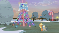 Applejack and Marble stand before the flag S5E20