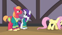 Fluttershy walking away from Rarity and Big Mac S4E14