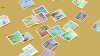 Photos scattered on the table S6E21
