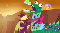 A dragon hugs Twilight in the dragon costume S2E21