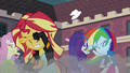 Equestria Girls shielding themselves from the wreckage EG3.png