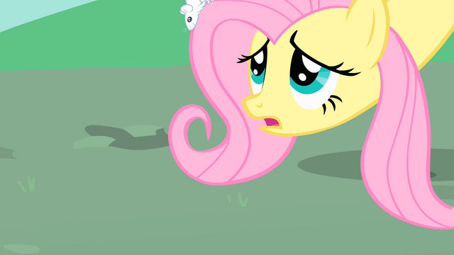 File:Fluttershy lowers her head so the mice can reach the ground safely S1E26.png