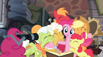 Pinkie Pie about to take a picture with her tail S4E09