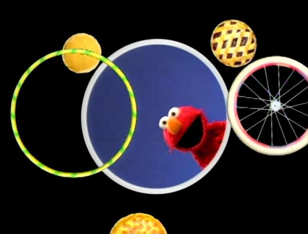 File:ElmoGoRound.jpg