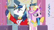 Shining Armor and Princess Cadance waving from the balcony S02