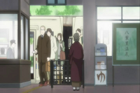 Chizu waiting at the train ticket entrance