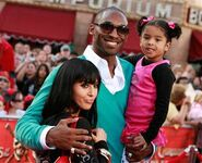 Kobe Bryant with wife Vanessa and daughter Natalia pose for the camera