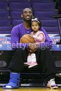 Kobe Bryant holding Natalia Bryant