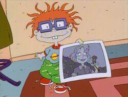 Chuckie with photo of Melinda