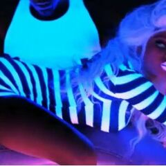 Nika is featured at the bridge of the Super Bass video.