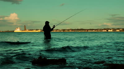 File:Stock-footage-fisherman-in-water-at-sunset-laboe-coastline-kiel-germany.jpg