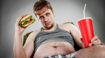 Fat Guy holding a burger and soda