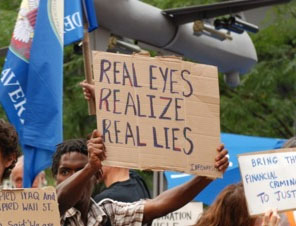 File:Sign- real eyes realize real lies.jpg