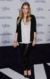Ashley Benson at Never Say Never Premiere in los angeles february 8 2011 purple red carpet leather pant
