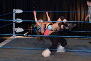 Nadia performs a German Suplex