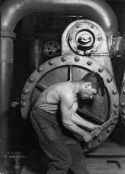 Lewis Hine Power house mechanic working on steam pump