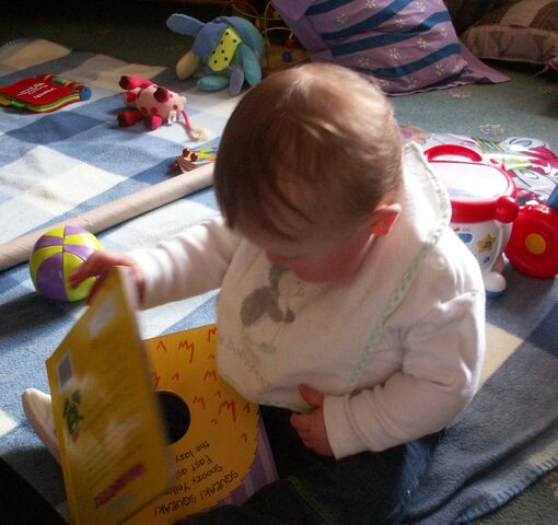 File:Baby exploring books.jpg