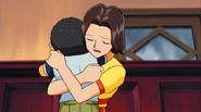Chino hugs his mother