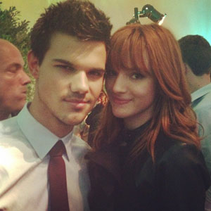File:Bella-thorne-taylor-lautner-breaking-dawn-premiere.jpg